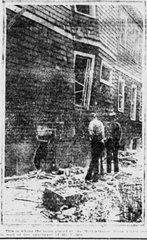 Image from the front page of the Paterson Evening News of June 4, 1919 showing a blown out window and a gaping hole in the concrete foundation where an anarchist bomb had exploded at 331 East 31st Street in Paterson.