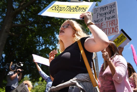 Shoshanna Finkle from Englewood raises her fist in the air during an abortion ban protest in Englewood on Tuesday May 21, 2019 to stand up and speak out against the numerous bills under consideration and being passed that would overturn Roe v. Wade and a woman's right to control her body.