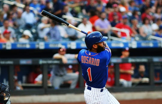 New York Mets shortstop Amed Rosario (1) hits a solo home run against the Washington Nationals during the first inning at Citi Field.