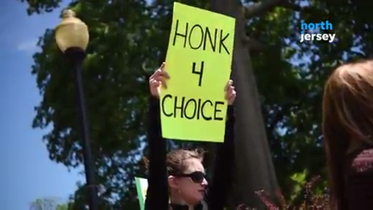 Pro-choice activists staged protests against a recent wave of measures curbing abortion rights across the country.