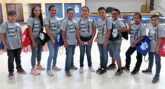 "Bataan Elementary School held its Math Olympiad competition on Wednesday, May 14. There were a total of 38 participants representing grades 3-5. All participants were given a Math Olympiad shirt, presented with a ""Star Student"" dog tag and were treated to ice cream. The top 3 winners for each grade level received a Wildcat string bag with goodies inside. Three 3rd-place winners also received a $10 gift card from Starmax Family Entertainment Center, three second-place winners received a $15 gift card from Starmax and the three 1st-place winners received a $25 gift card from Starmax. Pictured from left are: Jose Jara (5th grade-1st place), Jaydin Olmos (5th grade-2nd place), Paola Reyes (5th grade-3rd place), Daniel Porras (4th grade-1st place), Jayra Guerrero (4th grade-2nd place), Andrew Renteria (4th grade-3rd place), Nathaniel Ponce (3rd grade-3rd place), Jaime Solis (3rd grade-2nd place) and Marissa Edwards (3rd grade-1st place)."