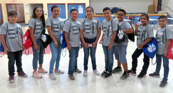 """Bataan Elementary School held its Math Olympiad competition on Wednesday, May 14. There were a total of 38 participants representing grades 3-5.All participants were given a Math Olympiad shirt, presented with a """"Star Student"""" dog tag and were treated to ice cream. The top 3 winners for each grade level received a Wildcat string bag with goodies inside. Three 3rd-place winners also received a $10 gift card from Starmax Family Entertainment Center, three second-place winners received a $15 gift card from Starmaxand the three 1st-place winners received a $25 gift card from Starmax. Pictured from left are: Jose Jara (5th grade-1st place), Jaydin Olmos (5th grade-2nd place), Paola Reyes (5th grade-3rd place), Daniel Porras (4th grade-1st place), Jayra Guerrero (4th grade-2nd place), Andrew Renteria (4th grade-3rd place), Nathaniel Ponce (3rd grade-3rd place), Jaime Solis (3rd grade-2nd place) and Marissa Edwards (3rd grade-1st place)."""