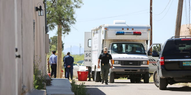 Members of the Doña Ana County Sheriff's Department investigate a double homicide in the 5300 block of Cristo Rey, Tuesday May 21, 2019.