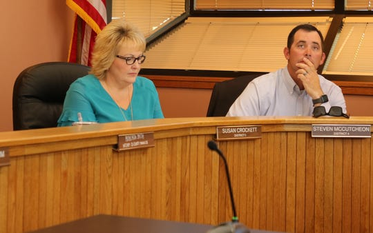 Eddy County Board of Commissioners Susan Crockett (left) and Steve McCutcheon look over budget numbers during a May 21, 2019 meeting.