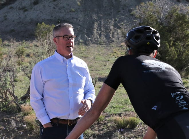 Aztec Mayor Victor Snover speaks to bicyclists, Saturday, May 4, 2019, prior to the Alien Run Mountain Bike Race.