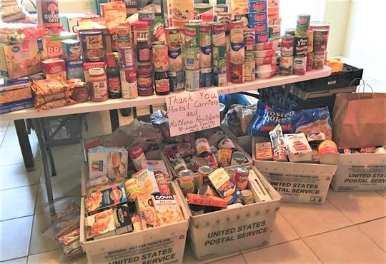 A bounty of food items collected by local lettercarriers helped stock the shelves of the Lincoln County Food Bank.