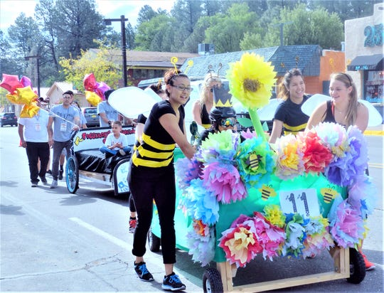 Taking the name flower bed seriously,  this team rolled down the street in the Great High Mountain Bed Race parade.