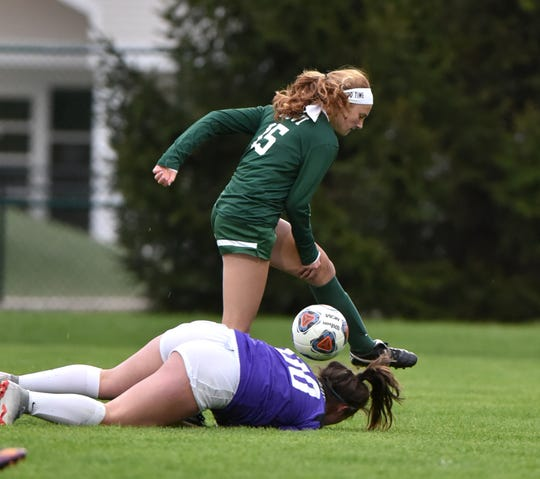 Wildcat Avery Fenchel nearly runs into Spartan goalie Mackenzie Fifer - but catches up with the ball to net Novi's first goal of the game.