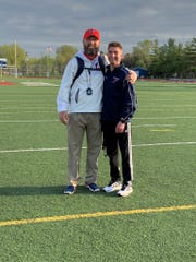 Livonia Franklin track and field coach Aaron Moran poses with Michael Mackiewicz.