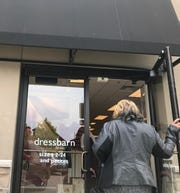 Patrons enter downtown Farmington's Dress Barn location on May 21. The clothing retailer will be closing its stores nation-wide in the coming months.