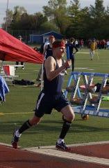 Livonia Franklin's Michael Mackiewicz runs his portion of a relay against John Glenn.