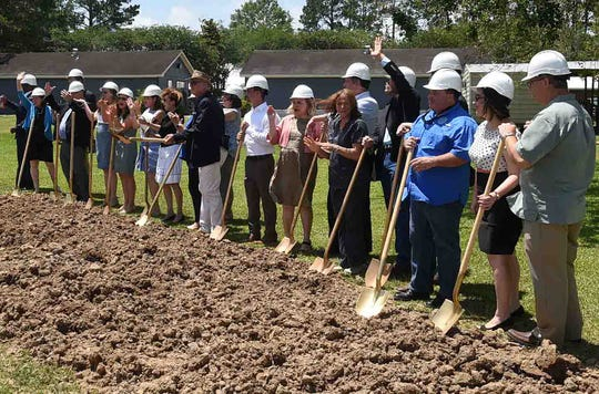 School officials and members of Westminster Christian Academy's board of directors shovel dirt to indicate the start of the 320-seat chapel located at the center of school property.