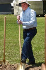 Former school director Ned Rutland leans on a shovel prior to the ground breaking ceremonies for the new chapel to be built at the Opelousas campus of Westminster Christian Academy held Tuesday.