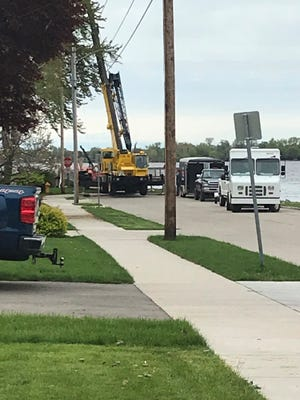 Authorities pull a vehicle out of Lake Winnebago around 9:15 a.m. Tuesday near the Bowen Street fishing dock.