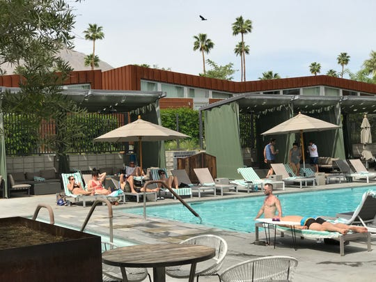 Guests enjoy the pool at ARRIVE Palm Springs in April 2018.
