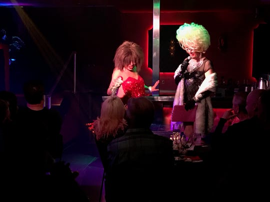 Sassy Ross, left, and Bella da Ball perform in 2018 during the weekly drag show at Copa Palm Springs,  Lipstick with Bella da Ball.