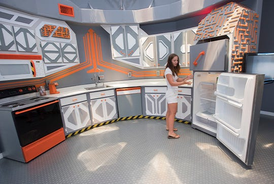 Asher Ko shows off the Navarre Area 51 House on Tuesday. She and her husband bought the dome-shaped house in Navarre Beach earlier this year and remodeled and redecorated it to resemble the inside of a spaceship.
