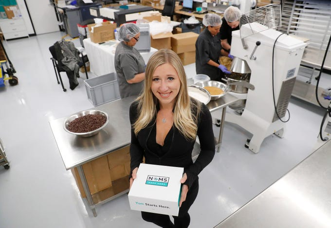 Chelsea Martin, co-owner of Noms Bake Shop, stands in her bakery in Phoenix May 7, 2019.
