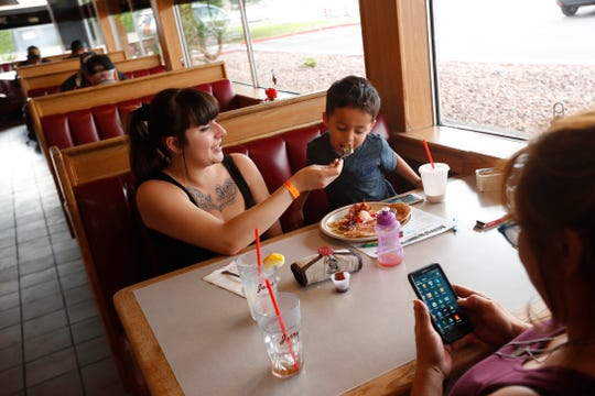Brandie Castellanos feeds her son Peter Castellanos, 3, at Jerry's, a diner in central Phoenix, on May 20, 2019.