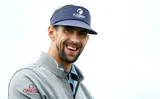 Michael Phelps walks off the first tee during the Annexus Pro-Am on Jan. 30 at the TPC Scottsdale Stadium Course.