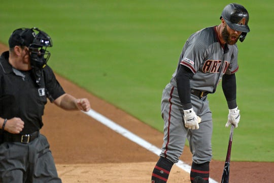 May 20, 2019: Arizona Diamondbacks first baseman Christian Walker (right) reacts as he is called out on strikes by umpire Marty Foster in the eighth inning against the San Diego Padres at Petco Park.