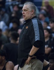 Mountain Pointe head coach Kirk Fauske communicates with this team during a game in January.