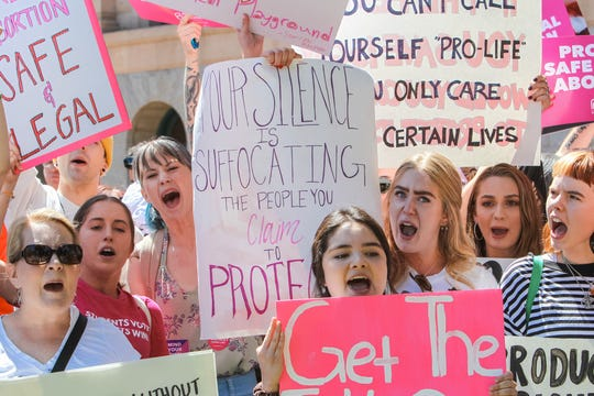 Abortion-rights activists gather at a rally to protest abortion bans at Arizona State Capitol in Phoenix on May 21, 2019.