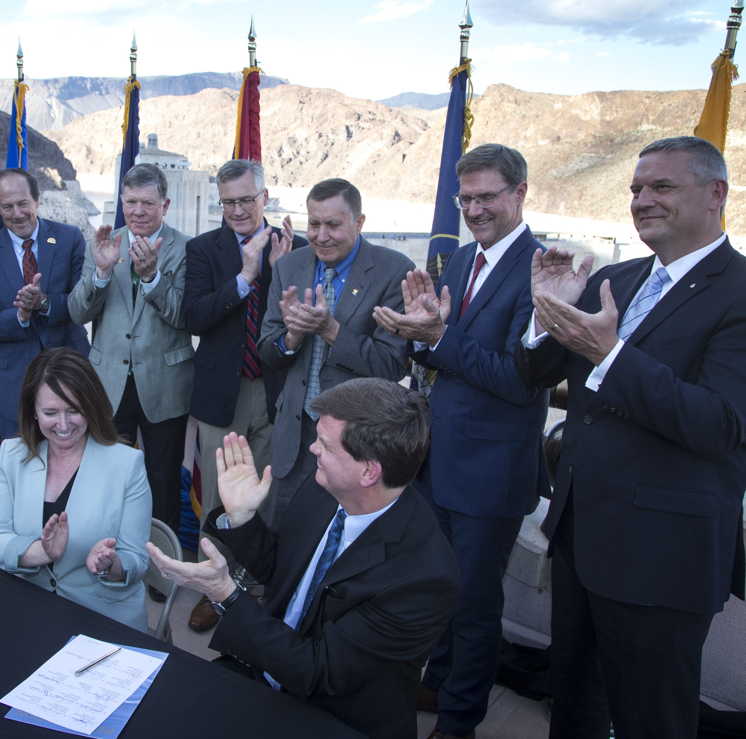 Dr. Tim Petty (right, Department of the Interior Assistant Secretary for Water and Science) and Brenda Burman (left, both sitting, Bureau of Reclamation Commissioner) after signing Colorado River Drought Contingency Plan, May 20, 2019, at Hoover Dam, Arizona/Nevada border. Looking on are representatives the from seven Colorado River Basin states, who also signed the plan.
