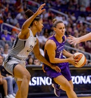 Phoenix Mercury forward Stephanie Talbot pushes the ball past Las Vegas Aces guard Jaime Nared during the first half of the Mercury's matchup against the Las Vegas Aces on Sunday, June 10, 2018, at Talking Stick Resort Arena in Phoenix, Arizona.