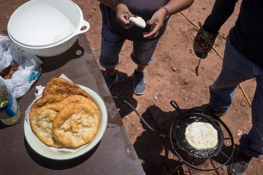Mattie Roam, Herman Lynch's sister, and Alfred Yazzie make fry bread, May 13, 2019, at the home of Ella and Herman Lynch in Oak Springs, on the Navajo Reservation.