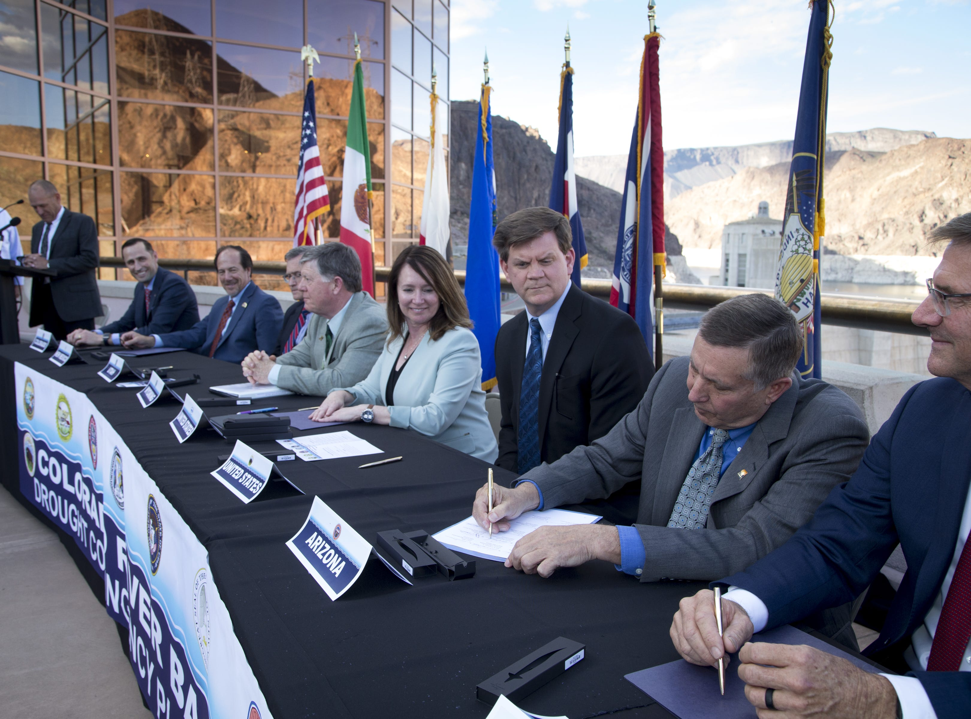 States sign short-term Colorado River drought plan, but global warming looms over long-term solutions