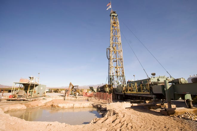 A rig drills a well in 2006 for a planned development in Golden Valley near Kingman. Mohave County has seen an influx of water users in recent years.