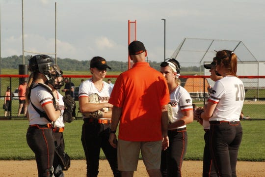 Coach Tod Whitman gathers his infield for a meeting during Palmyra's district playoff game against Northern last month.