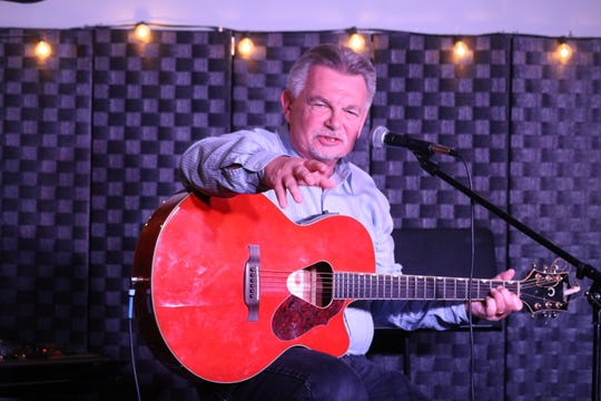Ron Miller, owner of The Listening Room, discussed the evolution of song during the writing process with Port Clinton High School's creative writing students.