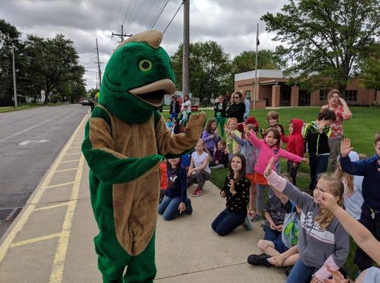 Willie Walleye greets Bataan students during parade celebrating the start of Right to Read Week.