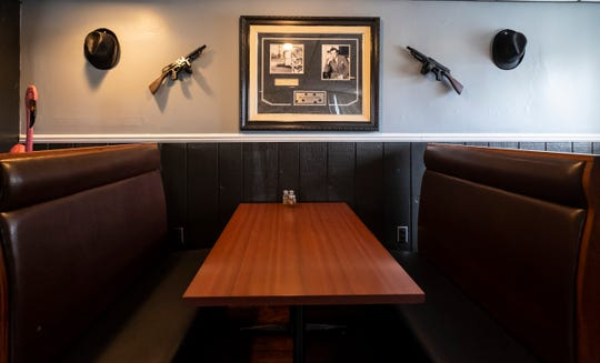"""Photos of Benjamin """"Bugsy"""" Siegel and the Flamingo Hotel hang above a booth inside Bugsy's American Grille in Algonac."""