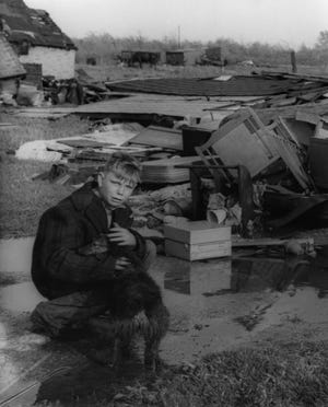 Herman Pringle and his dog are surrounded by the wreckage of the 1953 tornado that killed five people in Port Huron.