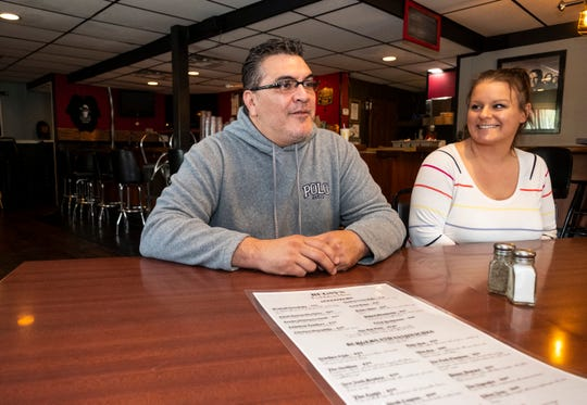Peter Norager, left, and Jami Preston, owners of Bugsy's American Grille in Algonac, discuss the restaurant's menu Monday, May 20, 2019.