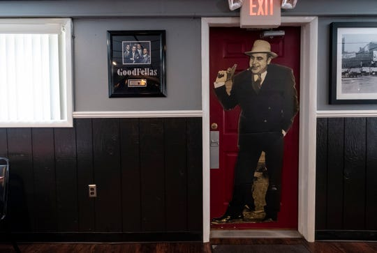 Mafia and gangster-related memorabilia is placed throughout the interior of Bugsy's American Grille in Algonac.