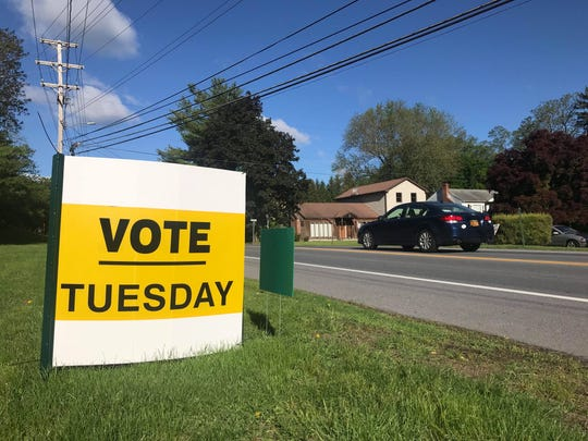 A sign outside Spackenkill High School reminds residents to vote on the school district's budget and choose which candidates will fill their open board of education seat on Tuesday, May 21, 2019.