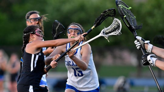 Kennard-Dale's Jenna Soukaseum, left, shoots and scores against Cocalico during the District 3 Class 2-A girls' lacrosse semifinal, Monday, May 20, 2019. John A. Pavoncello photo