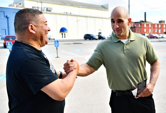 Tony Cucuzella, right, of York City, is greeted by York City Council candidate Lou Rivera during Primary Election Day at St. Matthew Lutheran Church in York City, Tuesday, May 21, 2019. Dawn J. Sagert photo