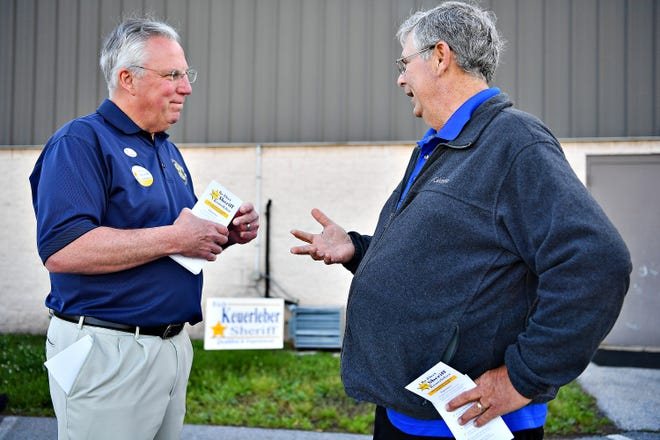 York County Sheriff Rich Keuerleber, left, greeted Ron Sisto, of Dover Township, outside of their polling location during Primary Election Day at Dover Township Community Center in Dover Township, Tuesday, May 21, 2019. Dawn J. Sagert photo