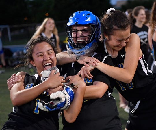 Kennard-Dale's Jenna Soukaseum, left, goalie Maria Schneider, and Amelie Gamache, right, celebrate after the Rams defeated Cocalico 12-11 to win the District 3 Class 2-A girls' lacrosse semifinal, Monday, May 20, 2019. 