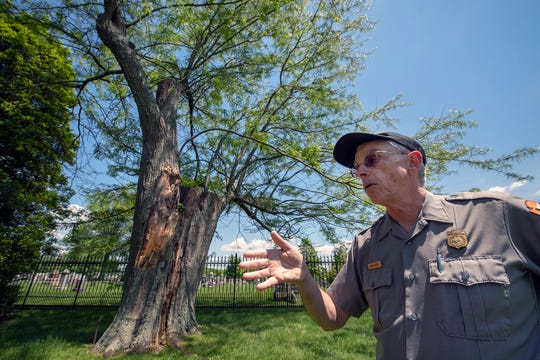 John Heiser, an historian with the Gettysburg National Park Service, talks about the honey locust tree behind him that was a witness to Lincoln's Gettysburg Address in the Gettysburg National Cemetery.