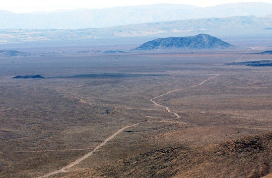 The top of Yucca Mountain, a proposed nuclear waste dump near Mercury overlooks vast expanses of vacant land.