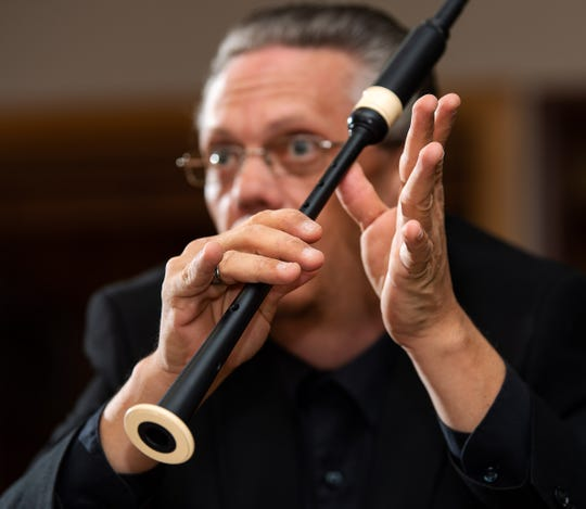 Aaron Pellegrini demonstrates proper fingering on his practice chanter.