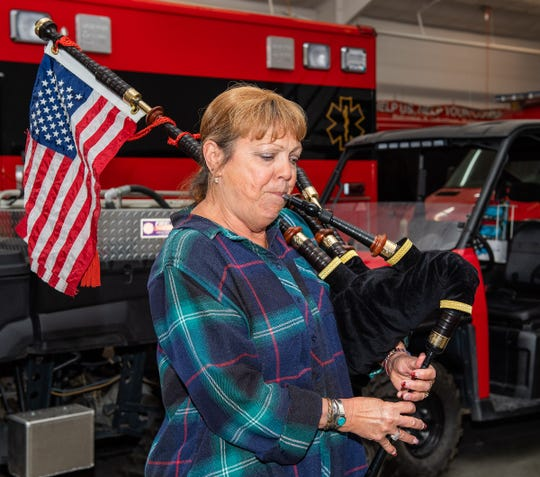Debbie Pellegrini plays the bagpipes.