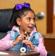Victoria Hernandez, 7, practices fingering on her chanter.