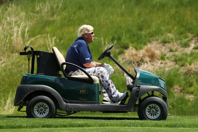 John Daly of the United States drives a cart on the 11th hole during the first round of the 2019 PGA Championship at the Bethpage Black course on May 16, 2019 in Farmingdale, New York.